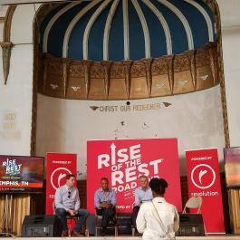 A Memphis resident speaks to J.D. Vance, John Hope Bryant and Steve Case at the May 8 Rise of the Rest pitch competition. (Madeline Faber)