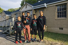 James Cook and his family stand outside the future home of Nubian Design Studios in Whitehaven. The building is currently under renovations with help from an EDGE Inner City Economic Development loan . (Ziggy Mack)
