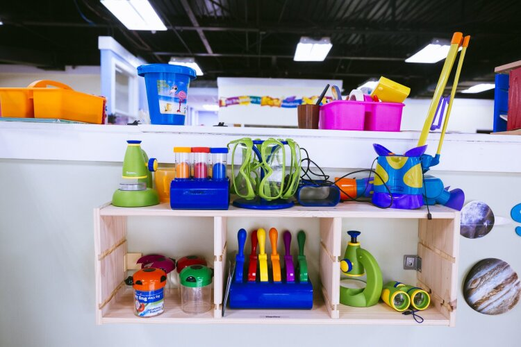 Tools for exploration including microscopes, goggles and collection jars line the shelves of Ready, Set, Grow Learning Academy. The center is STEAM-focused. (Ziggy Mack)