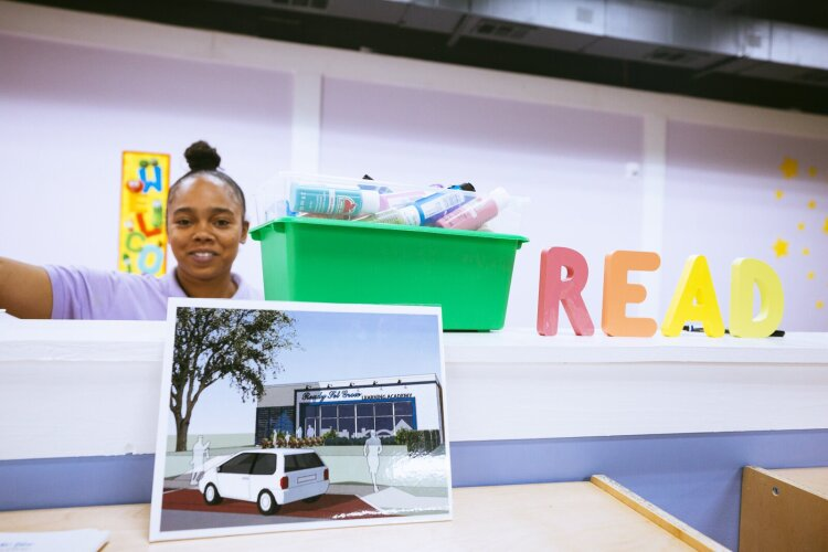 Instructor Akeidra WIlson stands in the bright and colorful Ready, Set. Grow Learning Academy. In the foreground, a rendering of Shamara Rogers' ultimate vision for her premier childcare academy. (Ziggy Mack)
