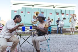 Residents of Madison Heights enjoy food from neighborhood restaurants while the Mighty Souls Brass Band plays an upbeat jazz number. (Ziggy Mack)