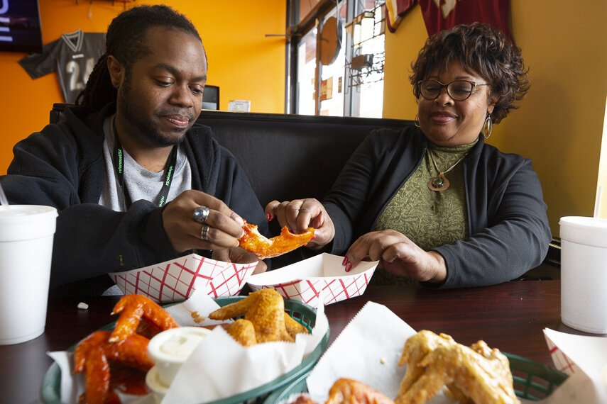 High Ground's A.J. Dugger and Hickory Hill resident Connice Nunn split a whole wing at Mike's Wings & Such. (Ziggy Mack)