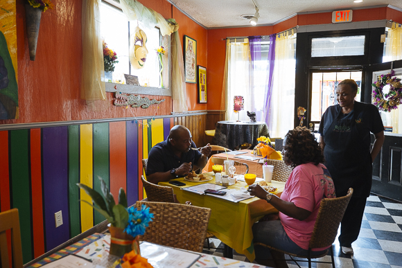 B.J. Chester-Tamayo serves patrons at Alcenia's restaurant in the Pinch District. (Ziggy Mack)