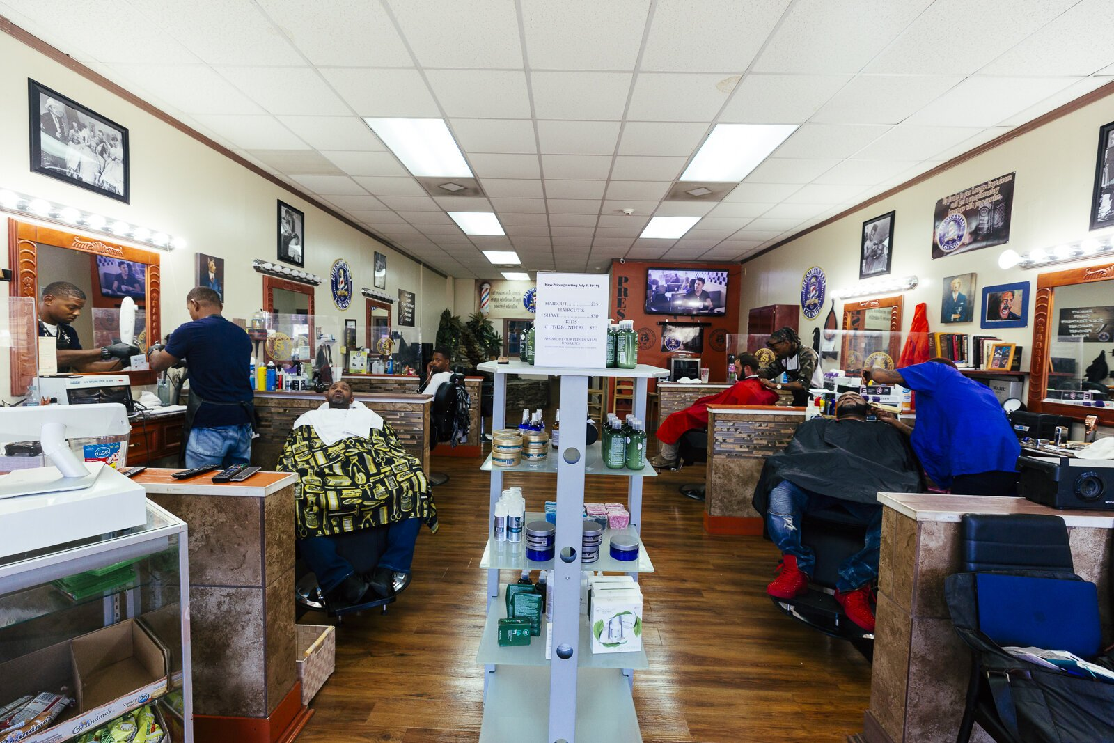 Barbers and clients at the Presidential Barber Lounge located at 1320 Madison Avenue in Madison Heights. (Ziggy Mack)