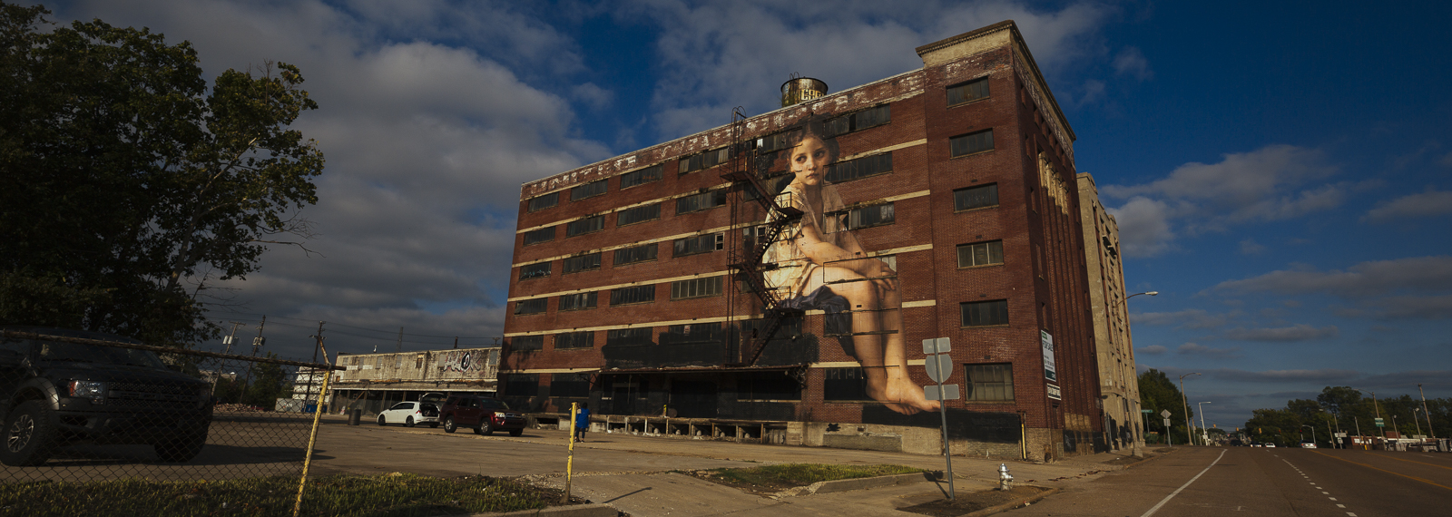 "As part of the Brooks Outing project, artist Julien de Casabianca pasted ""characters"" from earlier artworks in suprising places across Memphis. This snippet of ""Au pied de la falaise"" can be seen on Crump Boulevard. (Ziggy Mack) <span class='image-credits'></span>"