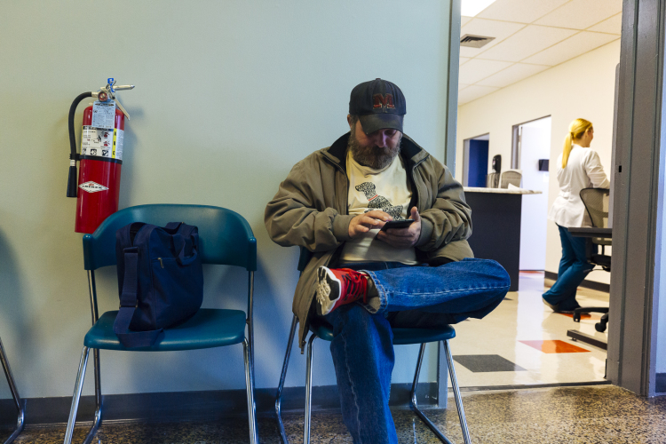 David Jones waits to receive care at the Baptist Operation Outreach clinic. (Ziggy Mack)