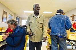 Pastor Jeffrie Howard, center, walks through diners at the Society of St. Vincent de Paul of Memphis's Ozanam Food Mission, March 2019. It was one of two area locations that served hot meals daily. COVID-19 has closed many soup kitchens. (Ziggy Mack)