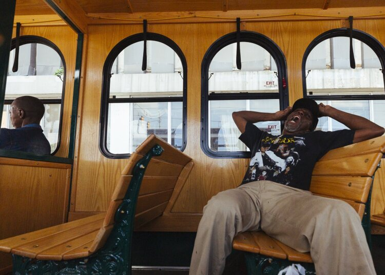 Self-identified street activist and Madison trolley line passenger Larry White yawns big between conversations with other passengers. (Ziggy Mack)
