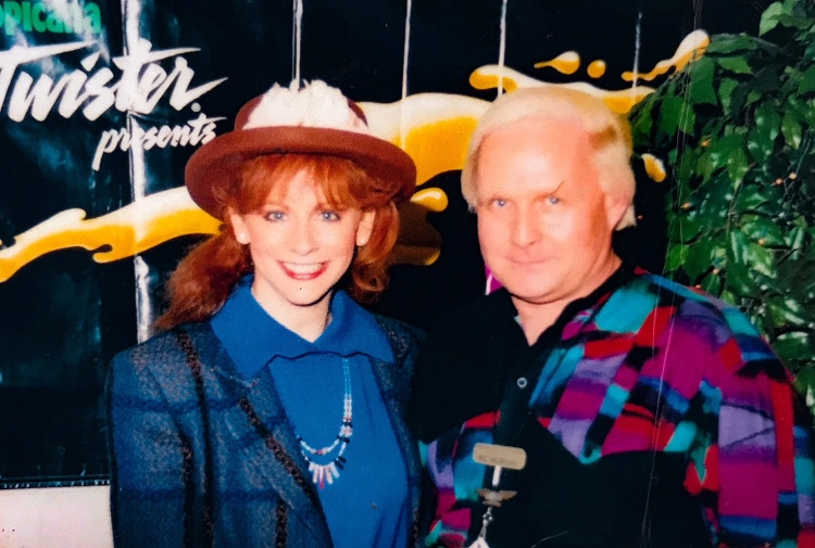 Ric Morgan (R) poses with Reba McEntire at a concert in 1994. Morgan says he was McEntire's touring caterer for 10 years. (submitted by Ric Morgan)