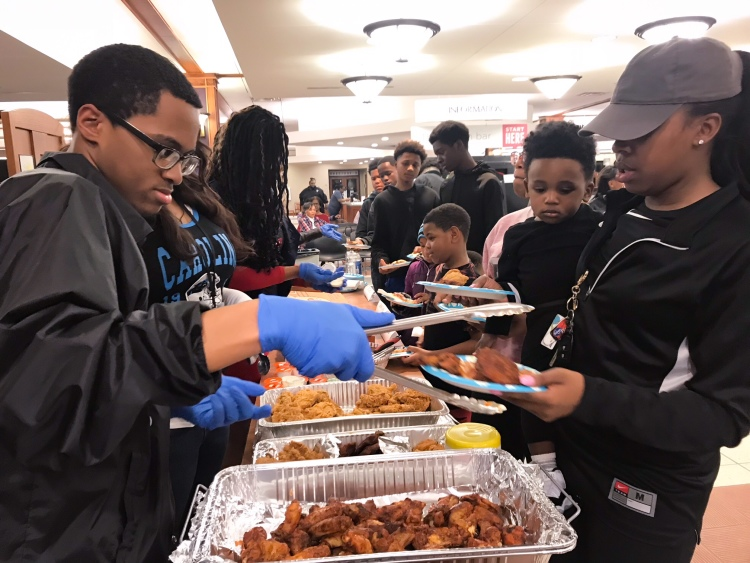 The staff served pizza, wings, fried chicken, chips and soda sponsored by the Friends of the Whitehaven Library and donated by three Whitehaven restaurants. (Cole Bradley)
