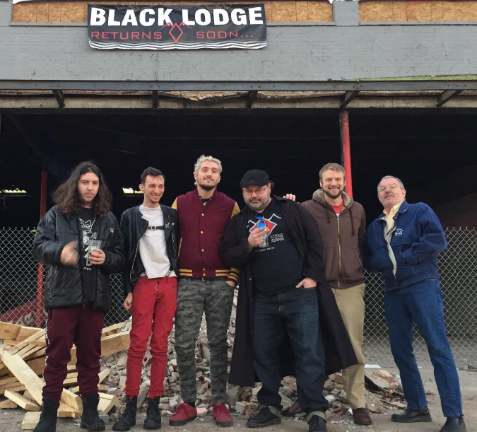 The six primary owners of Black Lodge at the new location at 405 N. Cleveland Avenue.