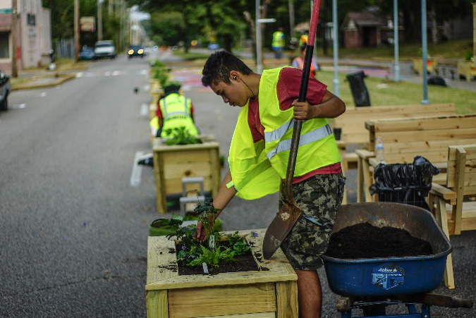 Volunteers installed planters that form a dividing wall to passing traffic on National Street.