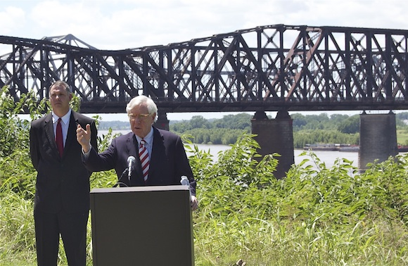 Charlie McVean addresses the press conference with the Harahan Bridge in the background