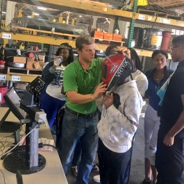 Student from Hamilton High School tries out welding through virtual reality technology at Barnhart Crane for National Manufacturing Day