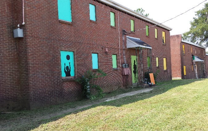 Artwork by MLK Prep students livens up the property during its renovation.