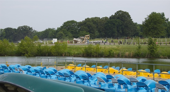 Construction and bison can be seen behind rental boats on Patriot Lake