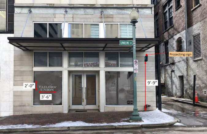 The ground-floor commercial space will receive exterior improvements and a more inviting alley presence before opening.
