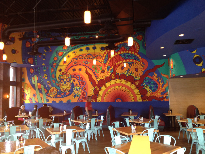 The restauarant's interior features a colorful Day of the Dead theme.