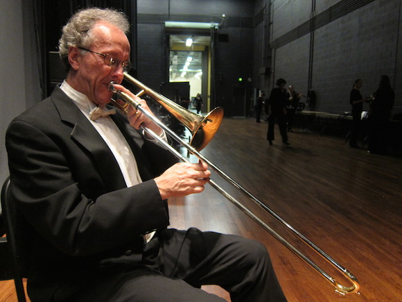 "Principal trombonist Greg Luscombe prepares for a performance of Beethoven's Symphony No. 6, ""Pastorale,"" at the Cannon Center"
