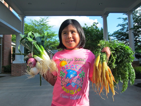 Elaine Parker, age 7, and her mother, Jennifer Parker, are members of Bring's It's weekly CSA subscription service