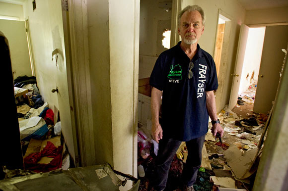 Lockwood stands inside the dilapidated house at 3131 Mountain Terrace in Frayser