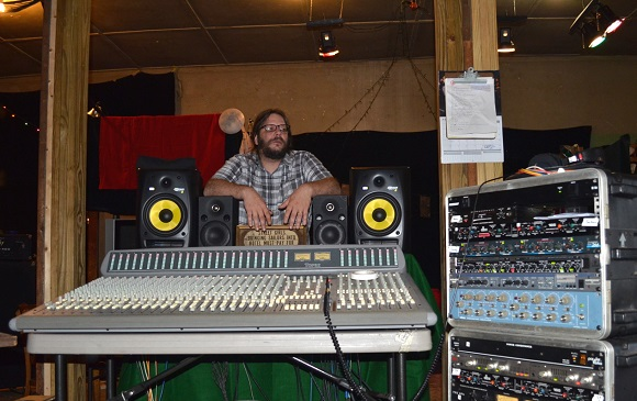 Robin Pack at Rocket Science Audio stands behind the console the studio purchased from the estate sale of Isacc Hayes