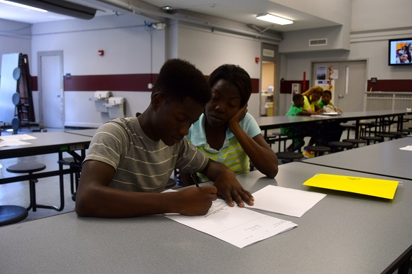 Incoming freshman Nathaniel Crawford registers for classes with the help of his mother, Daphne; school started on August 4th