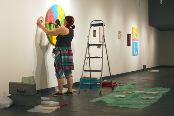 Mary Jo Kariminia installs her interactive art work
