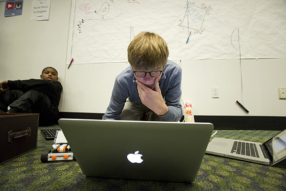 In the crowdfunded teen tech lab, Macon Orr, 15, grabs a moment to work on programming for a Bluetoo