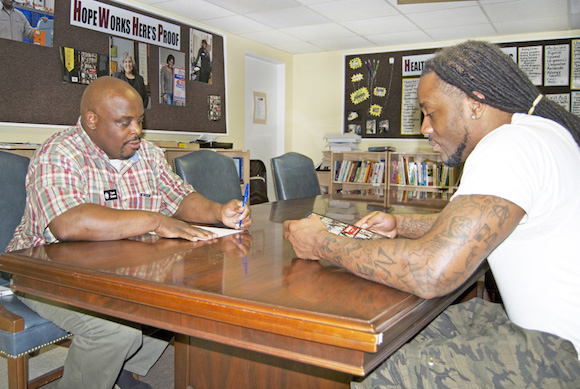 Antonio Owens, Personal and Career Development program instructor, meets with HopeWorks graduate Cortez Jones during his time as a student. One-on-one support is a key part of the Personal and Career Development program