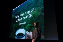 "Brendan Larkin at Ignite Memphis, Vol. 9. delivering his talk ""Why Your Cup of Coffee Costs $5"""