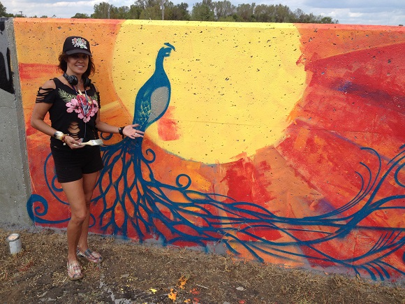 Former Memphian Beth Warmath came from Florida to join over 150 artists in painting the largest collaborative mural in Tennessee