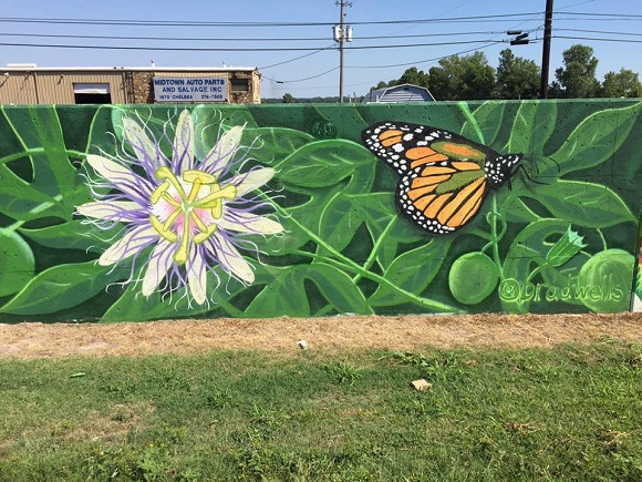 This panel by mural artist Brad Wells was completed last year on the south side of the flood wall along the Chelsea Greenline and was retained as a memorial tribute to him