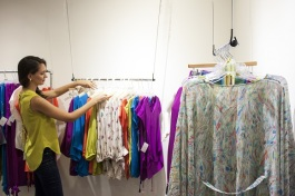 Dilettante Collection designer Tara Skelley offers her clothing for sale during opening night of The Lab's trunk show