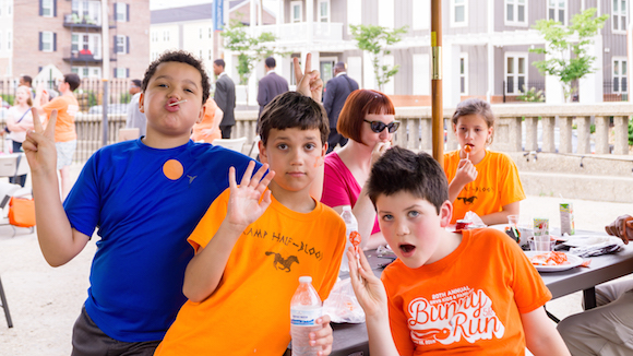 Kids celebrating at the June 2nd Wear Orange Event, which took place at Loflin Yard