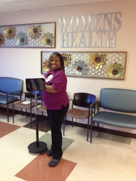 Venetia Bennett displays one of the kiosks used to gather patient feedback at the Women's Health Center of Christ Community Health Services.
