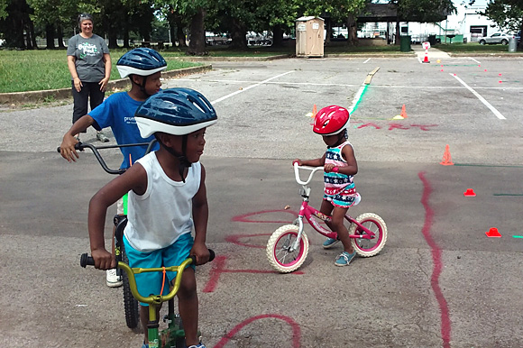 Children enjoy a bike rodeo at one of Memphis' 167 parks.
