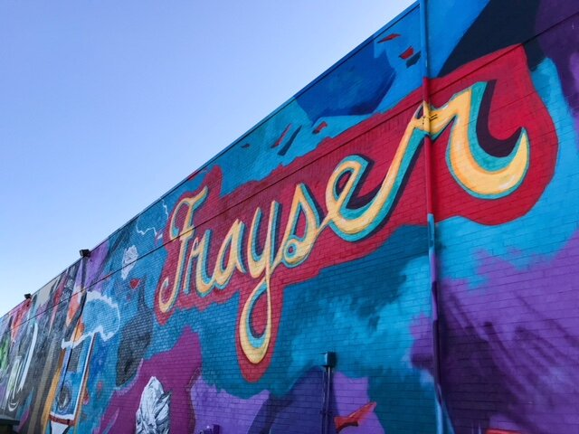 UrbanArts Commission's Art + Environment Initiative funded a mural in Frayser by artist Jamond Bullock. Bullock, like Khara Woods in Uptown, sought extensive input from community members before designing the mural. (Cole Bradley)
