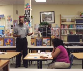Agape team member Marquis McPherson talks to parents at Whitehaven's A. Maceo Walker Middle School about Agape's community and school-based services. (Submitted)