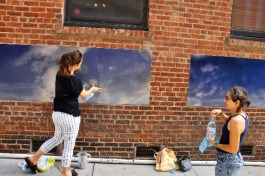 "Eszter Sziksz (L) and Stephanie Cosby (R) work on ""Skywalker"", an art installation in Barboro Alley."