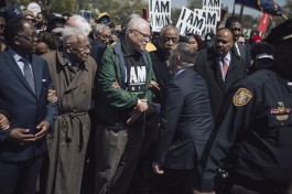 Rev. James Lawson (second from left), AFSCME president Lee Saunders, Al Sharpton and Rev. Martin Luther King III march together. (Andrea Morales/MLK50)