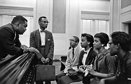 "Archie ""A.W."" Willis, Jr. stands at center. Seated are members of the Memphis State Eight. These students were the first to integrate what is now the University of Memphis."