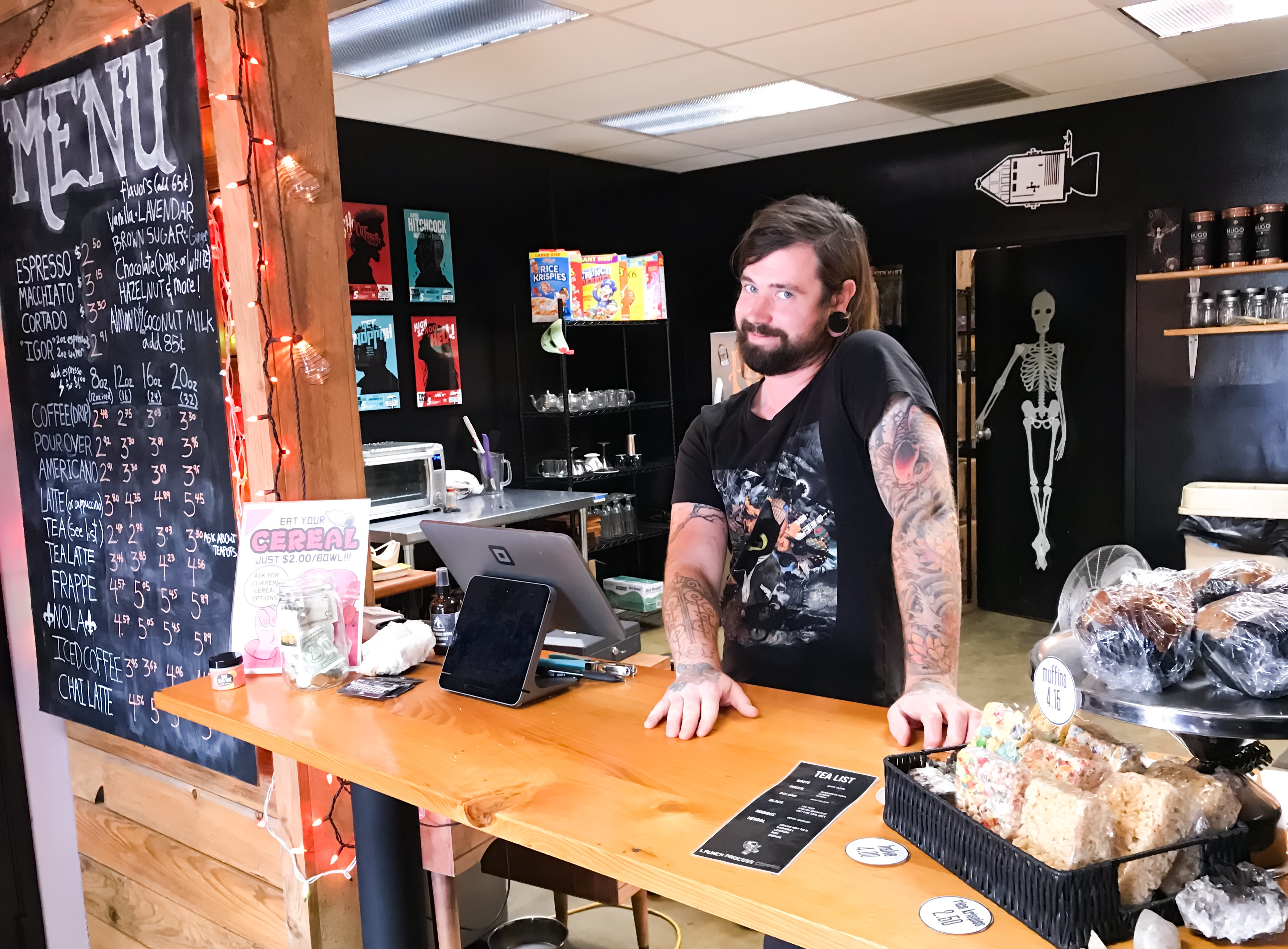 Jimi Myers stands at the counter of Launch Process Coffee at 584 Tillman Street, founded in May 2018. (Cole Bradley)