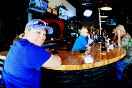 Tami Montgomery, owner of Dru's Bar, sits at the newly remodeled bar and chats with regulars after completing some chores around the business. The location, 1474 Madison Avenue, has been home to a number of LGBT bars since the 1970s. (Cole Bradley)