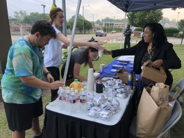 Students and faculty at the Southern College of Optometry participate in the 2018 Bike to Work Day, which included food and festivities at an outdoor registration table. (Submitted)