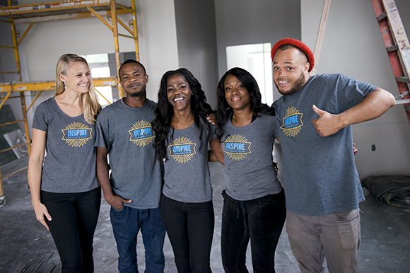 Inspire Community Cafe owner Kristin Fox-Trautman, left, poses for a photo with her team, from left, Tevin Whitley, Jacqueline Chandler, Charlena Branch, and Terrance Whitley, inside the restaurant which is currently under construction. (Brandon Dill