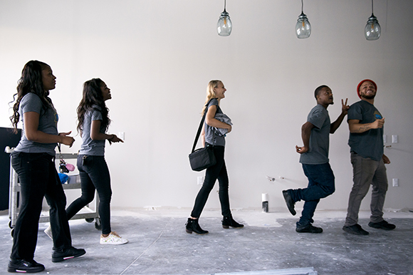 Inspire Community Cafe owner Kristin Fox-Trautman, center, walks with her team, from left, Charlena Branch, Jacqueline Chandler, Tevin Whitley, and Terrance Whitely, inside the restaurant which is currently under construction in Binghampton. (Brandon
