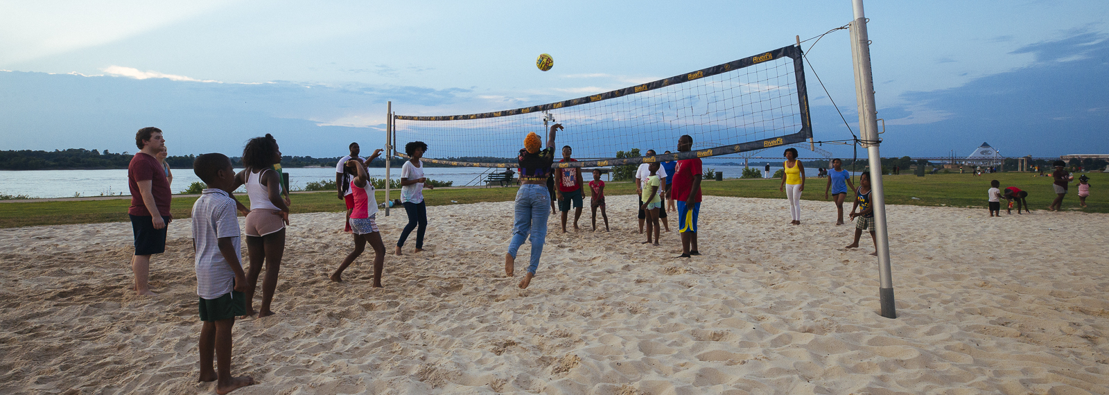 Memphians play a game of sand volleyball around sunset at Tom Lee Park. <span class='image-credits'>Ziggy Mack</span>