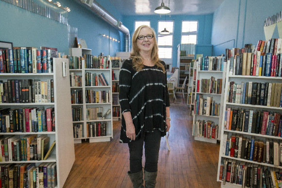 Jean Williams Andrus poses in her three-year-old Downtown bookstore.