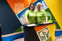 Pam Cooper, left, and Ginny Parker are promoting Boosterville at the Indiana PTA convention in early May. The Coopers have a strategic relationship with the National PTA. and have loaded in 32,000 PTAs across the country in the Boosterville app.